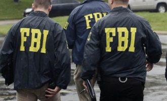 WATCH: Nigerian on FBI list caught on video spraying dollars
