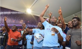 PHOTOS: Fans thrilled as Man City parade trophies in Lagos