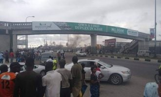 One shot dead as protesters burn police van in front of Lekki Shoprite