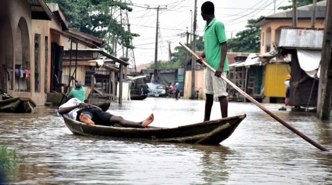 In flooded Lagos community, canoe replaces Uber and children are on forced holiday