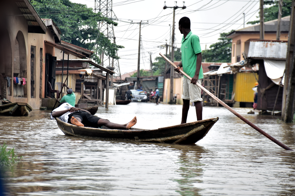 In flooded Lagos community, canoe replaces Uber and children are on forced holiday - TheCable