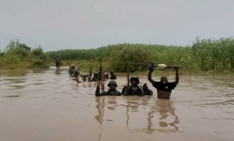 PHOTOS: Soldiers risk their lives in the river — just to stop Boko Haram