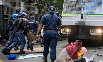South African police arrest 100 foreigners protesting xenophobia at UN site