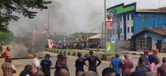 Tension in Benin as angry youth block roads ahead Oshiomhole's arrival from Abuja