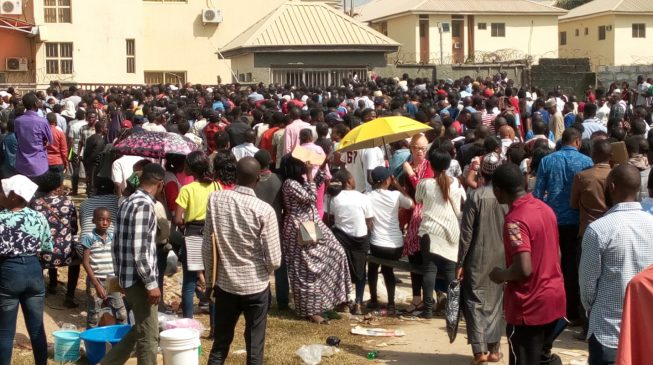TRENDING VIDEO: Job seekers scale fence just to write NDLEA test in Kano