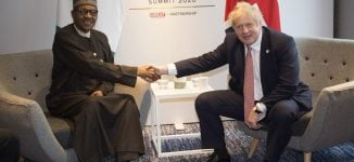 Buhari asks Britain to go after Nigerian fugitives in UK