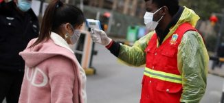 PHOTOS: Nigerian student volunteers to combat coronavirus in China