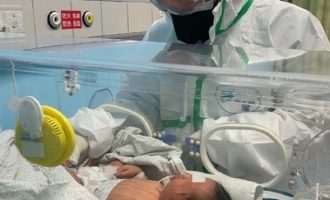 Newborn becomes youngest coronavirus patient as death toll hits 565