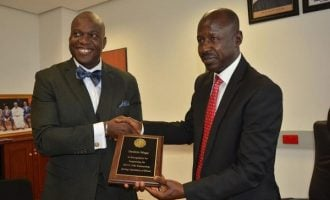 FBI honours Magu for helping US arrest '167 fraudsters' in Nigeria