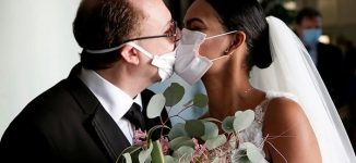 Couple wed in coronavirus face masks at ceremony with no guests in Italy – world's worst hit country