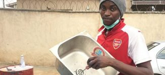 Nigerian man converts drums into wash-hand basins to help fight COVID-19