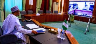 PHOTOS: Buhari holds teleconference with task force on COVID-19