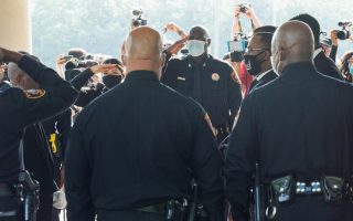 Salute from police as George Floyd is laid to rest