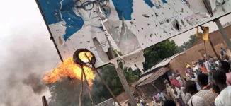 Angry protesters burn Buhari's billboard in Katsina