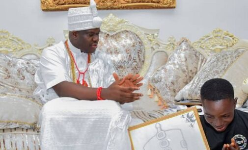 Ooni adopts, gives scholarship to son of corn seller who drew his portrait