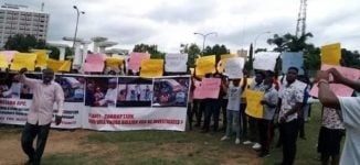 PHOTOS: Protesters demand arrest of Tinubu over 2019 election eve 'bullion vans'
