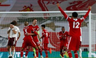 Liverpool overcome Arsenal to maintain perfect start