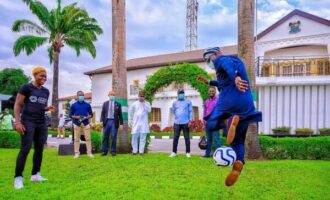 PHOTOS: Sanwo-Olu shows off football skills during Oshoala's visit