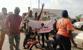 Airport road blocked as #EndSARS protest continues in Abuja