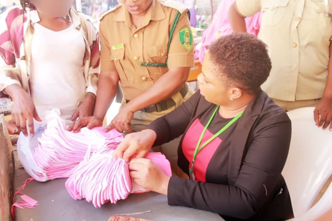 Dorcas Igharewa screening pads produced by the inmates