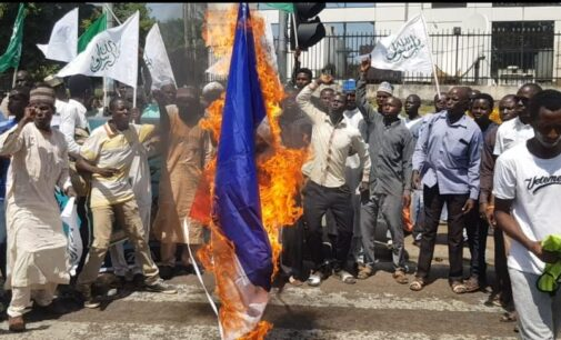 Shi'ites set French flag ablaze in Abuja over Macron's 'controversial' comment