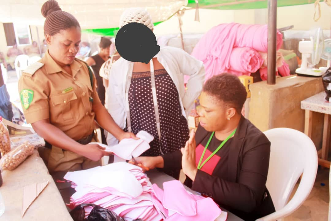 A prison officer and an inmate with Igharewa