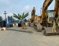 EXTRA: Road construction on hold in A'Ibom as resident 'places charms' on contractor's equipment