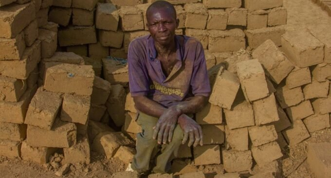 PHOTOS: Inside the world of local 'bulletproof' brickmakers in Abuja