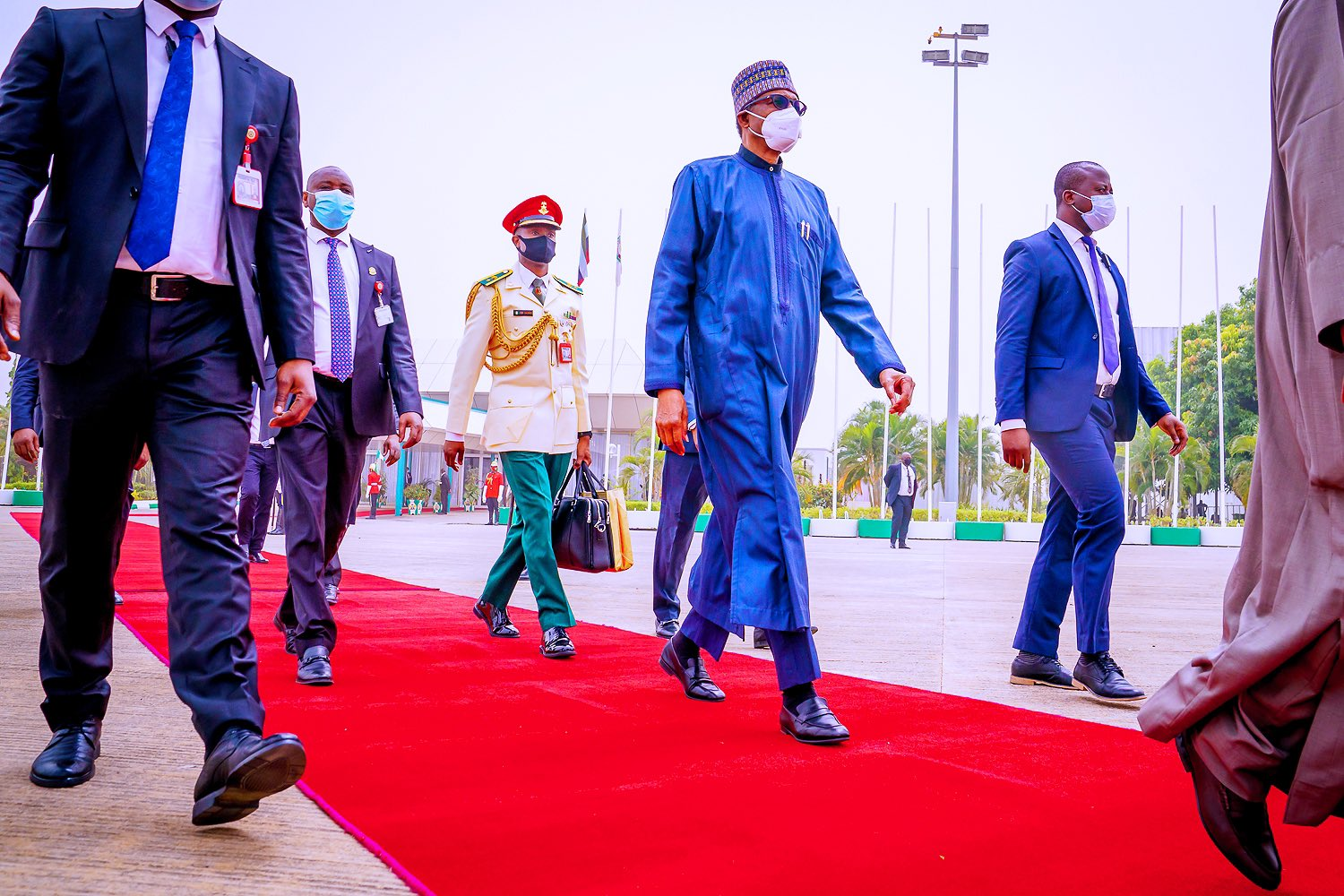 President Buhari marches out