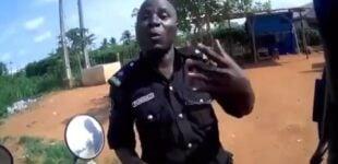 TRENDING VIDEO: Nigerian police officer begs Spanish biker for money