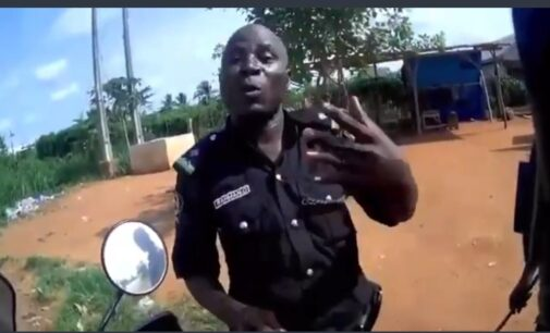 TRENDING VIDEO: Nigerian police officer begs Spanish biker for money