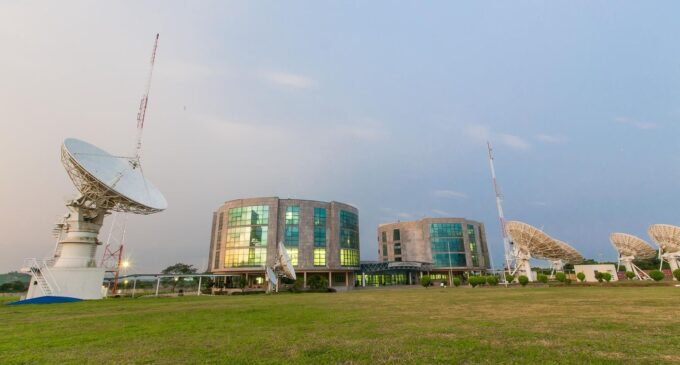 What is NIGCOMSAT's business with buying and launching satellites?